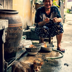 Woman and cat in lane