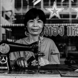 Woman working with old sewing machine
