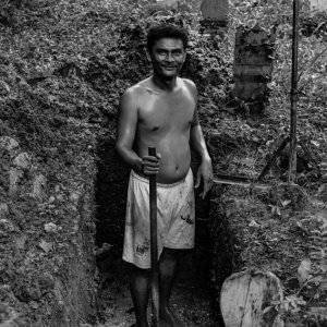 Man digging grave