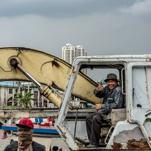Man thumbing up on excavator