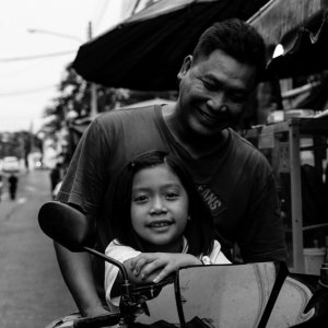 Father and daughter on motorbike