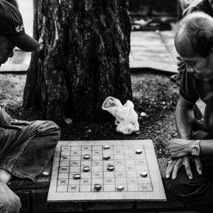 Men playing game on sidewalk
