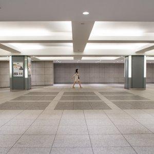 Woman walking spacious passage alone