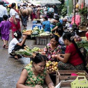 Women sitting on side of street market