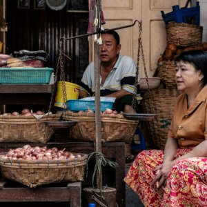 Man and woman selling onions and garlic