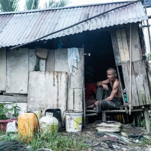 Man sitting in shanty house