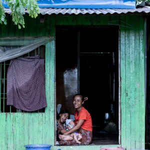 Mother smiling while nursing baby