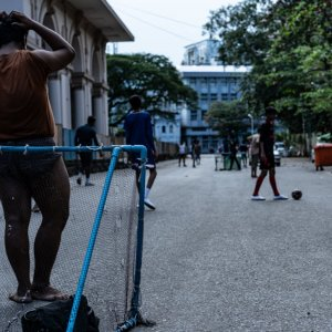 Young men playing football in downtown