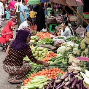 Woman with a hijab buying in greengrocery