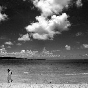 Woman walking Yarahama beach