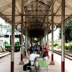 Man resting on platform of Insein station