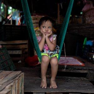Little girl sitting on hammock