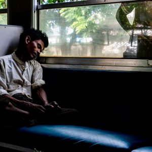Man sleeping well on train car