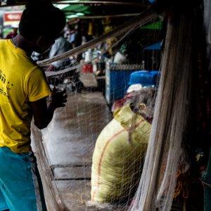 Man taking care of fishing net