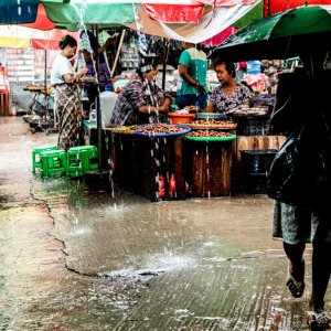 Woman walking market with umbrella