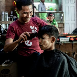 Barber cutting happily