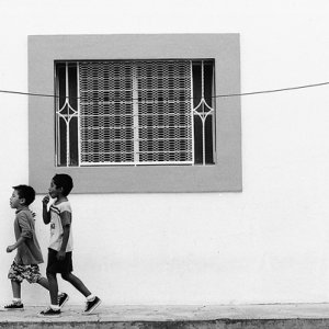 Boys passing by window