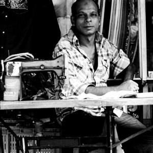 Man in front of sewing machine