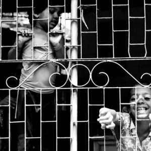 Children on other side of wire netting