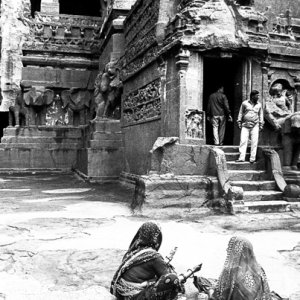 Two women in front of temple