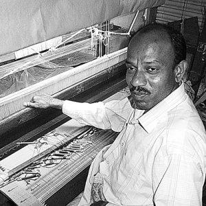 Man weaving Himroo