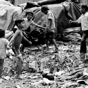 Boys playing in garbage