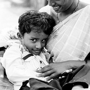 Boy nestling in mother's arm