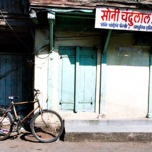 Bicycle in front of store