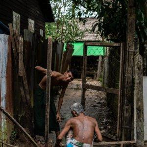 Men repairing gate