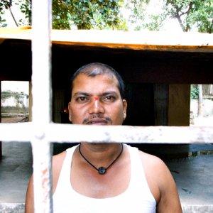 Man inside of fence