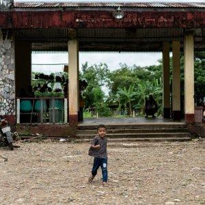 Boy walking alone in front of railway station