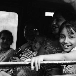 Smiling girl on car