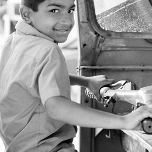 Boy holding steering wheel