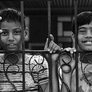 Boys against fence