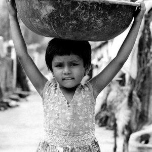 Girl carrying big bowl