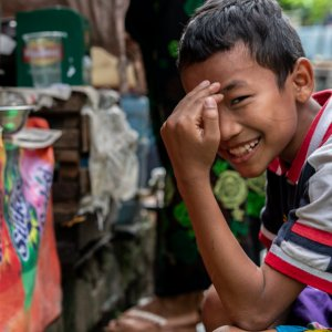 Boy laughing bitterly