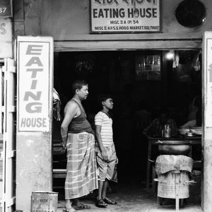 Two men in front of eating house
