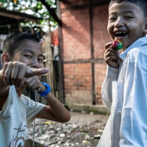 Boys playing spinning top