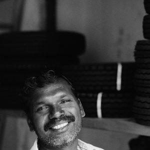Man smiling in shop
