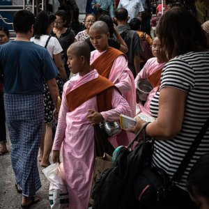 Buddhist nuns walking in crowds