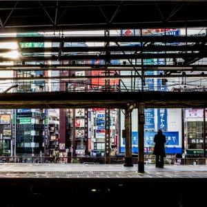 Figure standing alone on platform