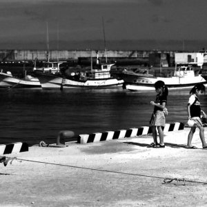 two girls playing in harbor in the isle of Irabu