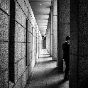 Man standing between pillars
