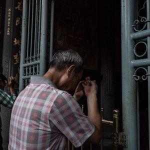 Man forming hand seal for praying