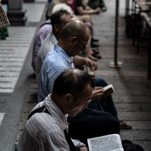 Men reciting sutra while sitting in Lungshan Temple
