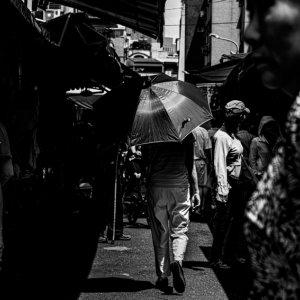 Umbrella among shoppers in Bailan Market