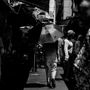 Umbrella among shoppers in Bailan Market