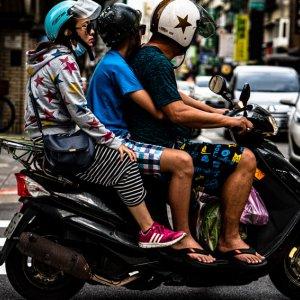 Family on the same motorbike