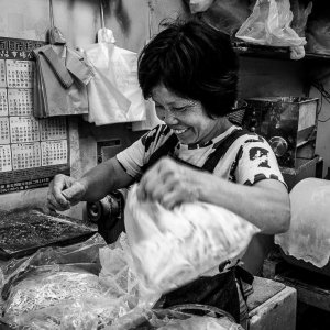 Bashful clerk working in a noodle making shop