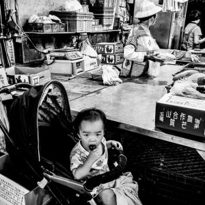 Baby on baby buggy in Chenggong Market